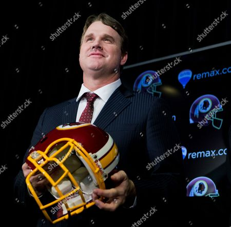 Jay Gruden New Washington Redskins head coach Jay Gruden, holds the team's helmet at the Redskins Park in Ashburn, Va., . Jay Gruden was introduced as the new Washington Redskins head coach, replacing Mike Shanahan and becoming the team's eighth head coach since Daniel Snyder purchased the franchise in 1999