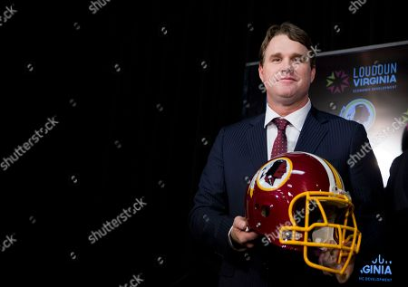 Jay Gruden New Washington Redskins head coach Jay Gruden holds a Redskins helmet at the Redskins Park in Ashburn, Va., . Jay Gruden was introduced as the new Washington Redskins head coach, replacing Mike Shanahan and becoming the team's eighth head coach since Daniel Snyder purchased the franchise in 1999