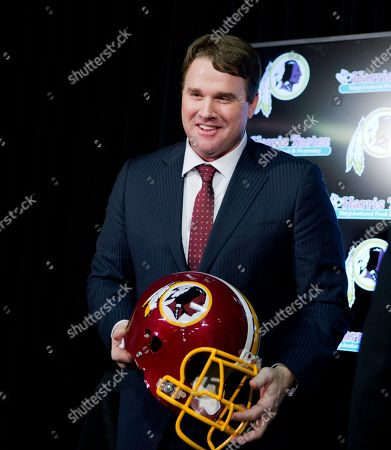 Jay Gruden New Washington Redskins head coach Jay Gruden, holds a Redskins helmet at the Redskins Park in Ashburn, Va., . Jay Gruden was introduced as the new Washington Redskins head coach, replacing Mike Shanahan and becoming the team's eighth head coach since Daniel Snyder purchased the franchise in 1999