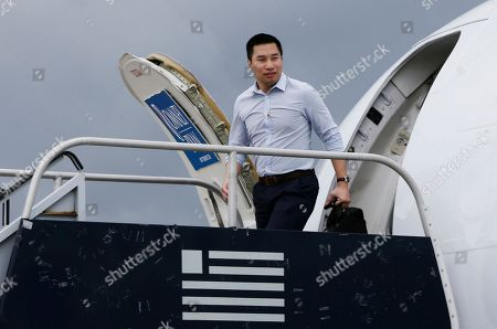 Alex Wong Alex Wong, foreign policy adviser to Republican presidential candidate and former Massachusetts Gov. Mitt Romney, steps off Romney's plane in West Palm Beach, Fla