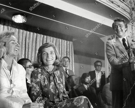 Sargent Shriver looks over towards his wife, Eunice, center, and his sister-in-law, Mrs. Ethel Kennedy, left, as he announces his candidacy for the Democratic presidential nomination, in Washington on . Mrs. Kennedy is the widow of assassinated Sen. Robert F. Kennedy