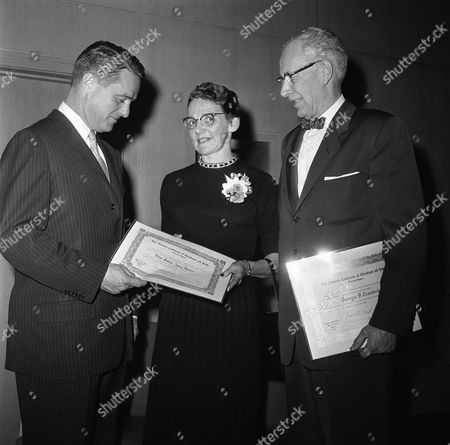 Robert Sargent Shriver Jr., left, President of the Board of Education, and the 1959 Brotherhood Week Chairman for Illinois, chats with Mrs. Wayne Potter, Grayslake, Ill., and George G. Crawford, right, editor the Waukegan News Sun, after they received their awards at ceremony in city hall in Chicago on