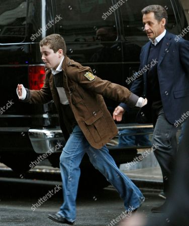 Nicolas Sarkozy, Louis Sarkozy French president Nicolas Sarkozy, right, runs across the street with his son Louis toward a waiting limousine before departing the Carlyle Hotel in New York, . Sarkozy is in the United States for two-day visit during which he is scheduled to meet with President Barack Obama