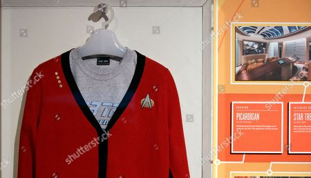 """A """"Picardigan"""" sweater (a play on Capt. Jean-Luc Picard and a cardigan sweater), is displayed as part of a 50th anniversary celebration of the Star Trek television show and films at the EMP Museum, in Seattle. """"Star Trek: Exploring New Worlds""""� opens Saturday, May 21, and is filled with geeky artifacts from all the Star Trek series and movies, and also illustrates how Star Trek was both a reflection of its times and a catalyst for social change--from a starring role by a black actress to a Russian actor featured during the Cold War and interracial and same sex relationships"""