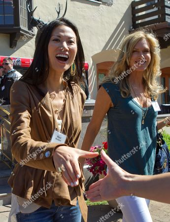 Wendi Murdoch, Kathy Freston Wendi Murdoch, left, and author Kathy Freston head to a luncheon after a morning session at the Sun Valley Inn for the 2011 Allen and Co. Sun Valley Conference, in Sun Valley, Idaho
