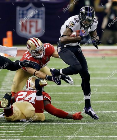 Jacoby Jones, Michael Wilhoite, Anthony Dixon Baltimore Ravens wide receiver Jacoby Jones (12) runs for extra yardage against San Francisco 49ers' Michael Wilhoite (57) and Anthony Dixon (24) during the NFL Super Bowl XLVII football game, in New Orleans