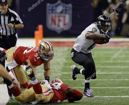Jacoby Jones, Anthony Dixon Baltimore Ravens wide receiver Jacoby Jones (12) jumps over San Francisco 49ers running back Anthony Dixon (24) during the first half of the NFL Super Bowl XLVII football game, in New Orleans. At left is 49ers linebacker Michael Wilhoite (57