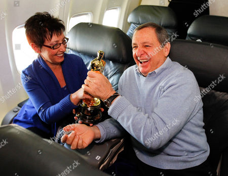Tom Sherak Academy of Motion Picture Arts and Sciences president Tom Sherak, right, and his wife Madeleine pose with a Oscar statue after landing at Los Angeles International Airport from Chicago in Los Angeles, . The awards will be distributed at the 84th annual Academy Awards on Feb. 26 at the Kodak Theatre in the Hollywood section of Los Angeles
