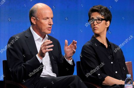 """Phil Griffin, Rachel Maddow Phil Griffin, left, president of MSNBC, answers a question as Rachel Maddow, host of """"The Rachel Maddow Show,"""" looks on at the NBC Universal summer press tour, in Beverly Hills, Calif. Griffin has lately sought to broaden MSNBC's outlook by taking on a greater variety of stories, even hiring a food correspondent, and there's been some uptick in the ratings the past few weeks. He changed the daytime lineup, ditching opinionated programs hosted by Ronan Farrow and Joy-Ann Reid and establishing a news-focused bloc with Jose Diaz-Balart, Andrea Mitchell and Thomas Roberts"""