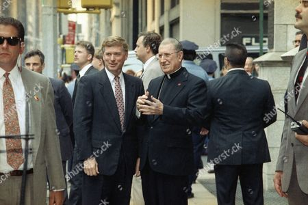 Dan Quayle, Cardinal John O Connor Amidst a covy of security men, right and background, Vice President Dan Quayle is welcomed by Cardinal John O'Connor outside the prelate's residence in New York's Madison Avenue
