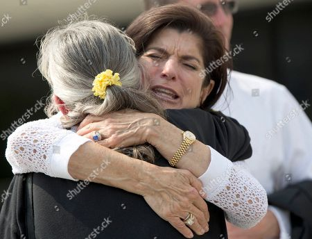 Luci Baines Johnson, daughter of president Lyndon B. Johnson, hugs Leah Smith Angers, who's brother was killed in Vietnam at the LBJ Presidential Library in Austin, Texas on during the library's three-day Vietnam War Summit