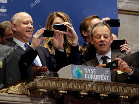 Jeffrey Sprecher,David Goone Intercontinentalexchange Chairman and CEO Jeffrey Sprecher, left, and ICE Chief Strategy Officer David Goone use their mobile phones before ringing the opening bell of the New York Stock Exchange, . The Dow Jones industrial average crossed 16,000 points for the first time early Monday and the Standard & Poor's 500 index crossed 1,800 points