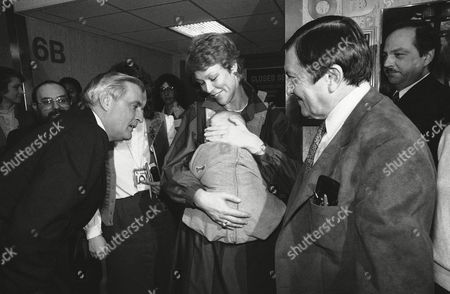Walter Mondale, Democratic presidential contender, left, greets two-month-old Michael Pressman, son of Gabe Pressman, right, and Vera Pressman, holding Michael, following a debate with Jesse Jackson and Gary Hart on New Yorks WNBC television, New York. Pressman moderated the debate
