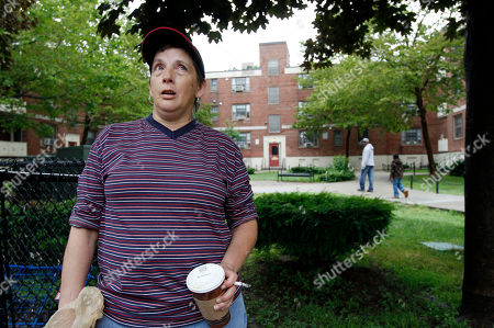 """Jennifer Lynch, of Boston, speaks with a reporter at the Mary Ellen McCormack housing development, in Boston's South Boston neighborhood, . Lynch said of Bulger """"He should get what he deserves."""" Bulger was arrested by the FBI in Santa Monica, Calif., Wednesday"""