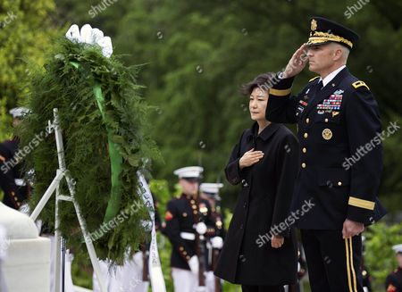 Park Geun-hye, Michael Linnington Shows South Korea President Park Geun-hye, left, with Maj. Gen. Michael Linnington, as taps is played during a wreath laying ceremony at the Tomb of the Unknowns at Arlington National Cemetery in Arlington, Va. Linnington, now retired from the military, plans to leave his post as director of the Defense POW/MIA Accounting Agency to become the CEO of the Wounded Warrior Project