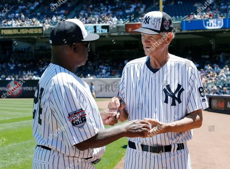 Rickey Henderson, Ralph Terry Former Yankee player Rickey Henderson, left, gets an autograph from former Yankee Ralph Terry before the Yankees annual Old Timers Day baseball game, in New York