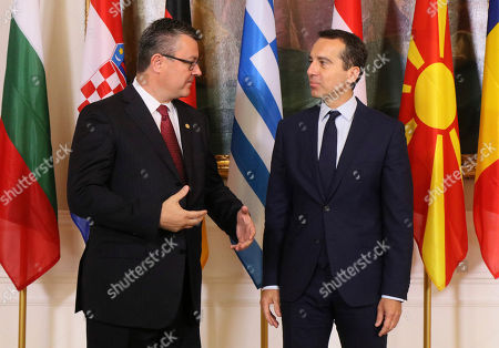 Croatian Prime Minister Tihomir Oreskovic is welcomed by Austrian Chancellor Christian Kern in Vienna, Austria, prior to a meeting of Kern and his German and West Balkans counterparts on strategies to deal with Europe's migrant crisis