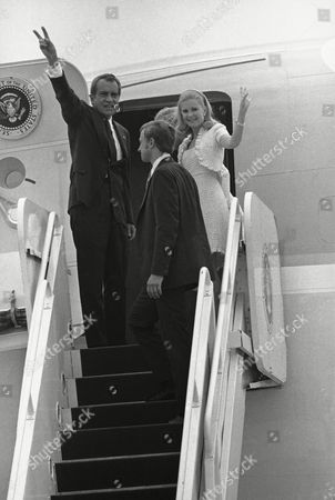 "President Richard Nixon, whose resignation will become effective at 12 p.m. EST Friday, boards the ""Spirit of 76"" with his wife, Pat, as they leave Andrews Air Force Base, Md. on in Washington. On the stairs is Tricia Nixon Cox, daughter of the president with her husband, Edward Cox. The plane's destination is San Clemente, California"
