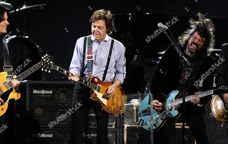 Rusty Anderson, Paul McCartney, Dave Grohl Rusty Anderson, left, Paul McCartney, center, and Dave Grohl perform during the 54th annual Grammy Awards on in Los Angeles