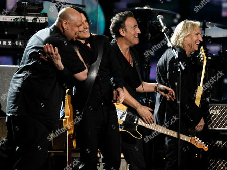 Abraham Laboriel Jr., Rusty Anderson, Bruce Springsteen, Joe Walsh From left, Abraham Laboriel Jr., Rusty Anderson, Bruce Springsteen, and Joe Walsh perform during the 54th annual Grammy Awards on in Los Angeles