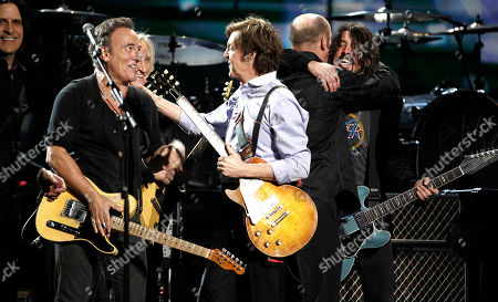 Rusty Anderson, Bruce Springsteen, Joe Walsh, Paul McCartney, Dave Grohl From left, Rusty Anderson, Bruce Springsteen, Joe Walsh, Paul McCartney, and Dave Grohl perform during the 54th annual Grammy Awards on in Los Angeles