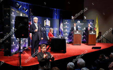 Jack Trammell, Dave Brat, Robert Lingren Randolph-Macon College president, Robert Lindgren, left, introduces Democrat Jack Trammell, right, and Republican Dave Brat, left at podium, for a debate at Randolph-Macon College in Richmond, Va., . The two candidates are running for the 7th district Congressional seat once held by Eric Cantor