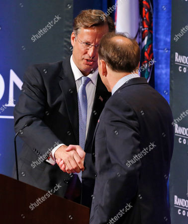 Stock Photo of Jack Trammell, Dave Brat Republican Dave Brat, left, shakes the hand of Democrat Jack Trammell, right, after their debate at Randolph-Macon College in Richmond, Va., . The two candidates are running for the 7th district Congressional seat once held by Eric Cantor