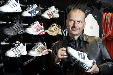 Stock Picture of STAMMINGER Adidas America President and CEO Erich Stamminger stands in front of an array of products following a interview, in Portland, Ore. Adidas acquired Reebok International Ltd. in a $3.8 billion merger. Stamminger contemplates what it's going to take for Adidas to knock Nike off its pedestal as the No. 1 athletic shoe and apparel company in the world