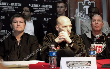 """Matthew """"Magic"""" Hatton of Great Britain, center, his brother Ricky hatton, left, and trainer Bob Shannon wait to speak during a press conference to promote their upcoming boxing match against Saul """"Canelo"""" Alvarez of Mexico, not shown, for the vacant WBC super welterweight world title, in Los Angeles . The bout will be the main event on a joint Golden Boy-R&R promotion at Honda Center in Anaheim, Calif., Saturday, March 5"""