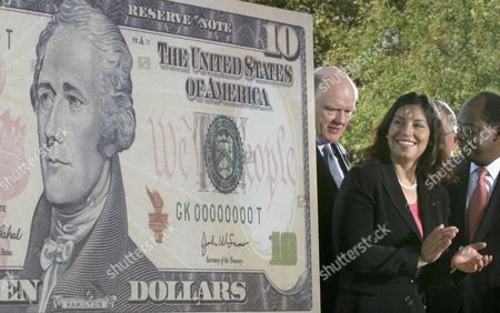 John Snow, left, Secretary of the Treasury; Anna Escobedo Cabral, Treasurer of the United States, and Roger Ferguson, Jr., right, Vice Chairman for the Board Of Governors of the Federal Reserve System, attend the unveiling of the new $10 note on Ellis Island in New York harbor. The announcement in June 2015 that the $10 dollar bill's redesign would replace Hamilton with a woman was welcomed but questioned. Some have asked: Couldn't the more controversial, slave-owning President Andrew Jackson be removed from the $20 bill instead