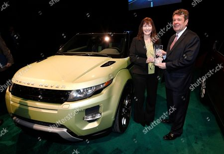 Stock Picture of Kim McCullough, Andy Goss Kim McCullough, Brand Vice President, and Andy Goss, President, Land Rover North America, hold the North American Truck of the Year trophy for the Land Rover Range Rover Evoque at the North American International Auto Show in Detroit