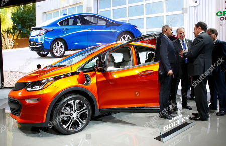 U.S. Transportation Secretary Anthony Foxx, from left, and National Highway Traffic Safety Administration Administrator Mark Rosekind listen to Mark Reuss, General Motors Executive Vice President of Global Product Development talk about the 2017 Chevrolet Bolt EV at the North American International Auto Show in Detroit, . Foxx said Thursday that the National Highway Traffic Safety Administration also will develop a model policy for states to follow if they decide to allow autonomous cars on public roads. That policy - which will be developed within six months - could help form the basis of a consistent national policy