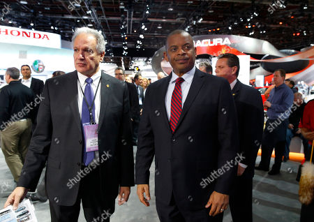 National Highway Traffic Safety Administration Administrator Mark Rosekind, left, and U.S. Transportation Secretary Anthony Foxx, tour the North American International Auto Show in Detroit, . Foxx said Thursday that the National Highway Traffic Safety Administration also will develop a model policy for states to follow if they decide to allow autonomous cars on public roads. That policy - which will be developed within six months - could help form the basis of a consistent national policy
