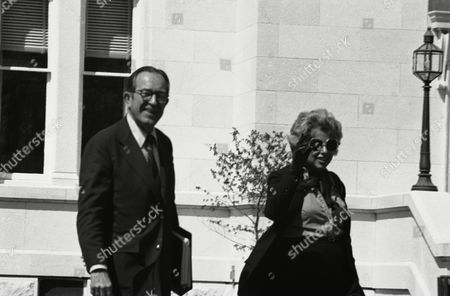 Attorney General Griffin Bell and HUD Secretary Patricia Harris, walk toward helicopters, in Washington, en route to Camp David, Md. President Carter has summoned his Cabinet and senior advisers to a summit meeting to discuss problems of his 15-month-old administration