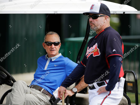 Fredi Gonzalez, John Hart Atlanta Braves manager Fredi Gonzalez, right, talks with John Hart, president of baseball operations, during a spring training baseball workout, in Kissimmee, Fla