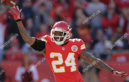 Stock Picture of Brandon Flowers Kansas City Chiefs cornerback Brandon Flowers (24) tosses the ball to free safety Abram Elam after a intercepting a Peyton Manning pass during the first half of an NFL football game against the Denver Broncos at Arrowhead Stadium in Kansas City, Mo