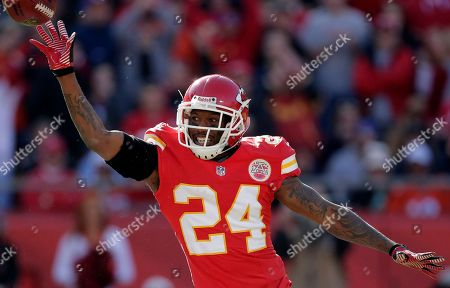 Brandon Flowers Kansas City Chiefs cornerback Brandon Flowers (24) tosses the ball to free safety Abram Elam after intercepting a Peyton Manning pass during the first half of an NFL football game against the Denver Broncos at Arrowhead Stadium in Kansas City, Mo