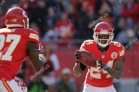 Brandon Flowers, Abram Elam Kansas City Chiefs cornerback Brandon Flowers (24) tosses the ball to free safety Abram Elam after a intercepting a Peyton Manning pass during the first half of an NFL football game against the Denver Broncos at Arrowhead Stadium in Kansas City, Mo