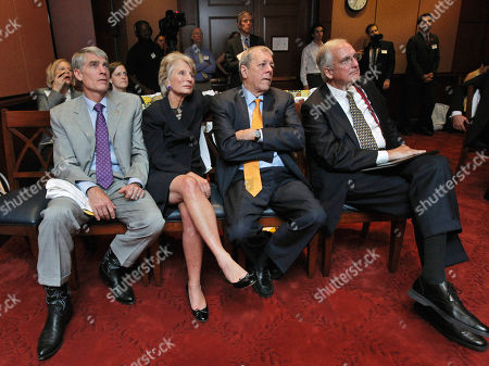 """Mark Udall, Jane Harman, John Tanner, Bob Livingston From left; Sen. Mark Udall, D-Colo., President and CEO, and Director of the Woodrow Wilson International Center for Scholars and former Rep. Jane Harman, D-Calif., former Reps. John Tanner, D-Tenn., and Bob Livingston, R-La., watch the presentation at the Wilson Center's re-launching of the """"Budget Game"""" on Capitol Hill in Washington"""