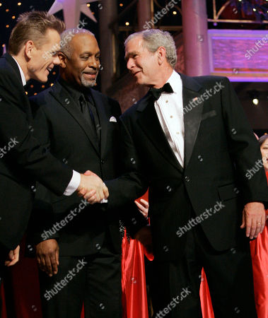 George W. Bush, Christopher Titus, James Pickens Jr President Bush shakes hands with comedian Christopher Titus, left, and actor James Pickens Jr., at Ford's Theatre, in Washington