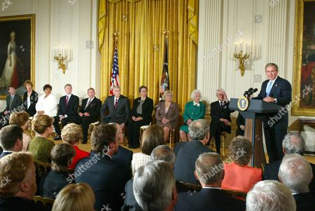 President Bush speaks at the ceremony for the 2003 recipients of the Presidential Medal of Freedom in the East Room of the White House . Recipients are, from left: Charles Barzun, grandson of Jaques Barzun; Ms Philadelphia Cousins, nephew of Julia Child; Vera Clemente, wife of Roberto Clemente; Van Cliburn; Vaclav Havel; Charlton Heston; Wendy Teller, son of Edward Teller; Lorraine Thomas, wife of David Thomas; Marion White, wife of Byron White and John Wooden. The medal is the highest civilian award of the U.S. Government