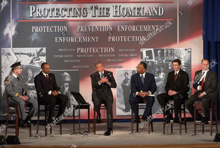 THOMPSON President Bush speaks in support of the Patriot Act at Kleinhans Music Hall in Buffalo, N.Y., . Listening to President Bush, from left to right, John Moslow, Chief of Police, Amherst, N.Y., Michael Battle, U.S. Attorney, Western, N.Y., Larry Thompson, former Deputy Attorney General, James McMahon, Director of Public Security, N.Y., Peter Ahearn, Special Agent in Charge, FBI, Buffalo, N.Y