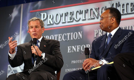 BUSH THOMPSON As former Deputy Attorney General Larry Thompson looks, President Bush delivers his remarks on the Patriot Act in Buffalo, N.Y