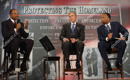 BUSH THOMPSON BATTLE President Bush and former Deputy U.S. Attorney General Larry Thompson, right, listen to U.S. Attorney for the Western District of N.Y. Michael Battle, left, during an event highlighting the Patriot Act in Buffalo, N.Y