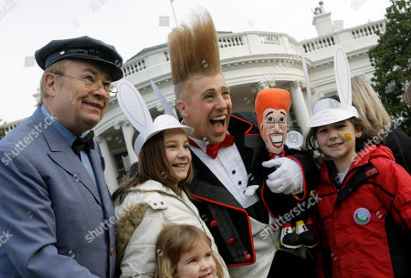 Mr. McFreely, Bello Nock Circus clown Bello Nock, center, and Speedy Delivery's Mr. McFreely from Mister Rogers' Neighborhood, left, are photographed with some unidentified children as they take part in the White House Easter Egg Roll, on the South Lawn at the White House in Washington
