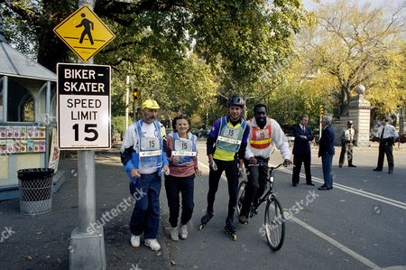 Monroe Novak Gotbaum Lebow Fred Lebow, president of the N.Y. Roadrunners Club, left, and Parks Commissioner Betsy Gotbaum, second from left, run past one of the 48 speed limit signs to be installed in New York's Central Park, . Steven Novak, president of the Big Apple Rollerskaters Association, second from right, and former Knicks' star Earl Monroe, right, are two of the many park visitors who will yield to the fifteen-mile-per-hour limit