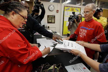 "Karen Lewis Chicago Teachers Union President Karen Lewis, left, registers for her ballot during a strike authorization vote at a high school in Chicago. Chicago Mayor Rahm Emanuel last week announced an agreement with several unions to help bail out the nation's worst-funded city pension systems, a festering problem inherited from his predecessor, Richard M. Daley. Emanuel said the deal, which would slice Chicago's nearly $20 billion shortfall in half by cutting benefits and raising property taxes, would keep the funds from insolvency and avoid massive cuts in services and a record tax hike. Among its opponents is Lewis who calls the pension plan ""criminal"" and ""just awful,"" saying it will hit school employees _ who don't receive Social Security and are predominantly women of color _ with both a loss of benefits and, for those who own homes, a property tax increase they can't afford to pay"