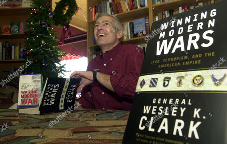 """CLARK Presidential candidate, retired Army General Wesley K. Clark, signs copies of his books, """"Winning Modern Wars"""" and """"Waging Modern War,"""", in Little Rock, Ark"""