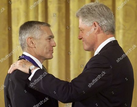 CLINTON CLARK President Clinton, right, awards the Presdiential Medal of Freedom to General Wesley K. Clark, during ceremonies in the East Room of the White House, in Washington, DC