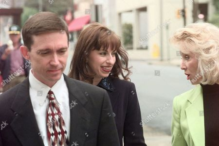 JONES MCMILLAN CAMPBELL Paula Jones, center, talks with her publicist Susan McMillan, right, as they cross a Little Rock, Ark., street with Mrs. Jones' lawyer Don Campbell as they return to a legal firm where depositions are being taken in Jones' sexual harassment lawsuit against President Clinton on